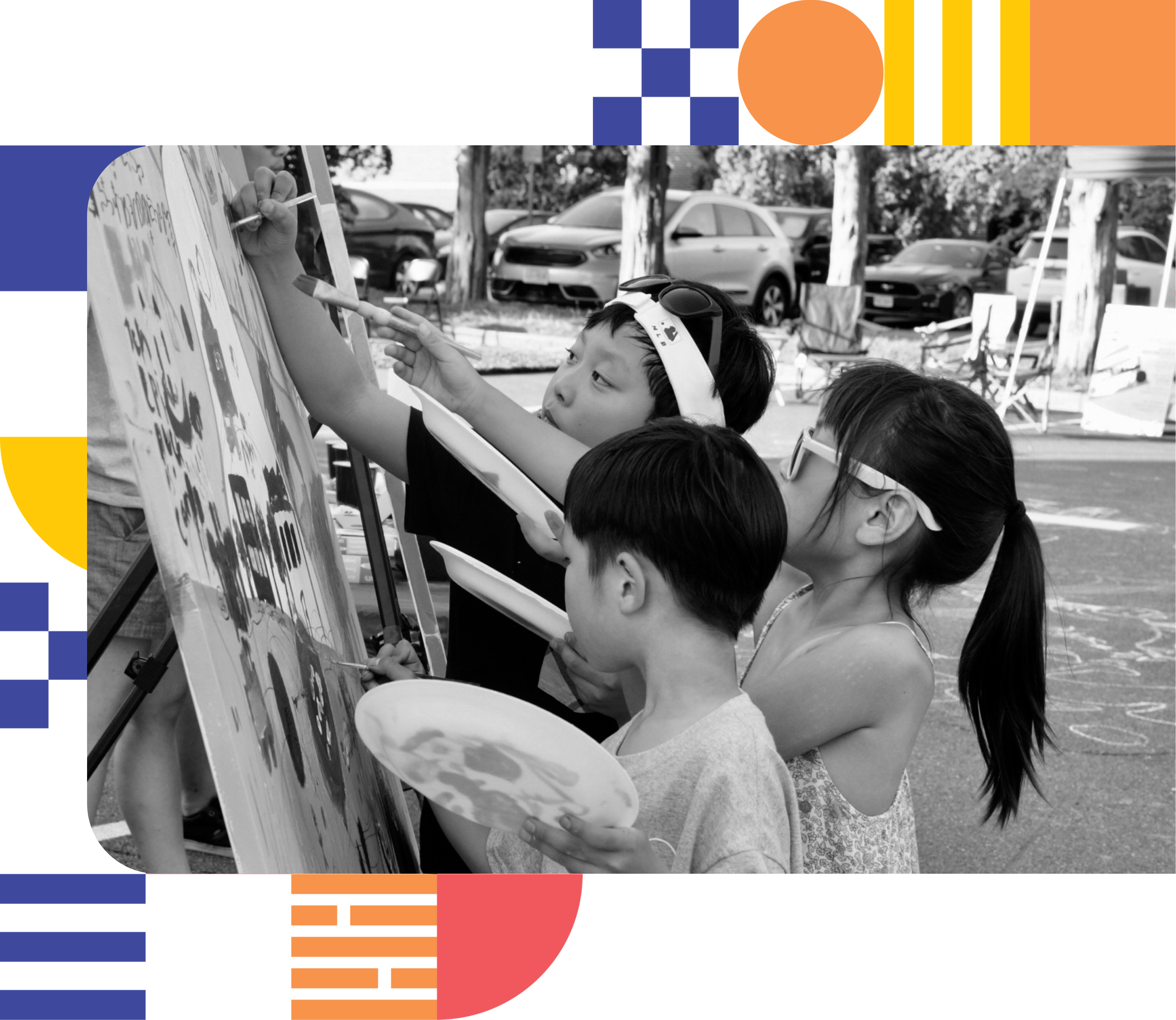 3 children painting together on a canvas featuring a map of Annandale.